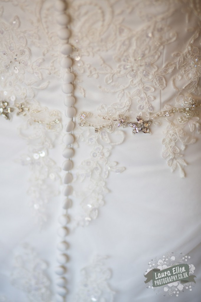 Ivory lace wedding dress with button, beading and diamante detailing