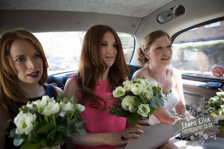Bride and Bridemaids in London Black Cab with bouquets