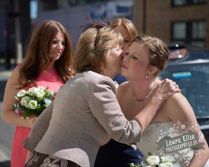 Mother of the Bride kisses the Bride