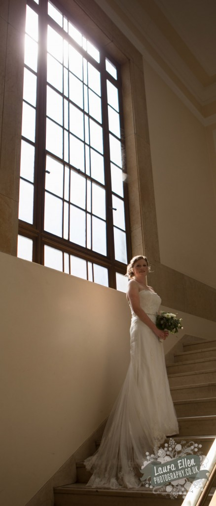 Bride standing on the stairs of Hackney Town Hall