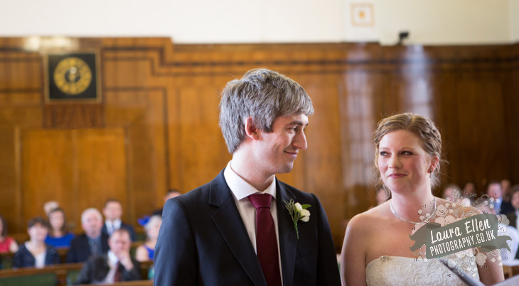 Bride and Groom smiling at each other at Hackney Town Hall wedding