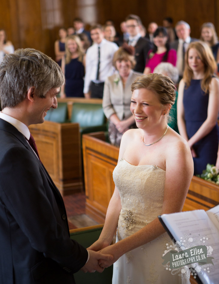 Bride and Groom holding hands at Hackney Town Hall wedding
