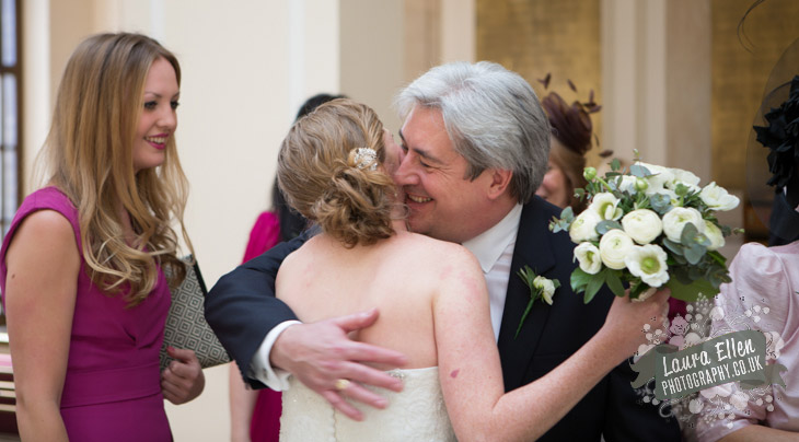 Bride hugs Father of the Groom