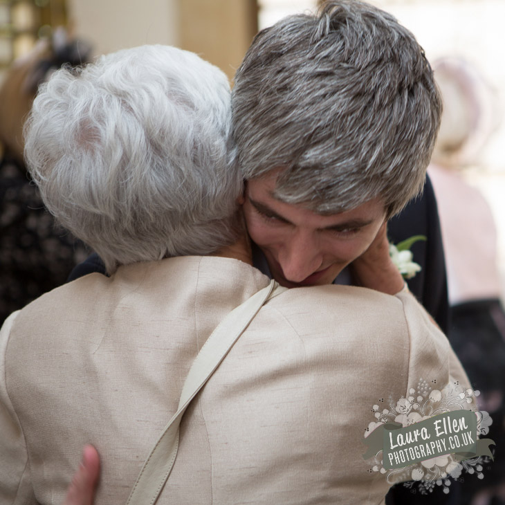 Groom hugs his Grandmother