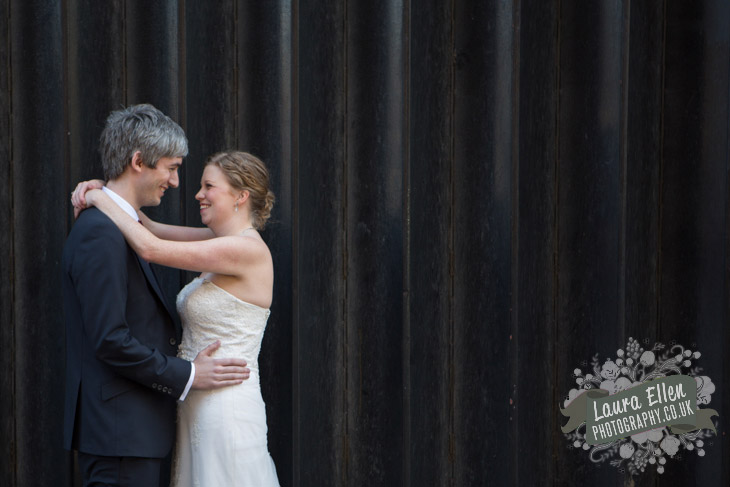 Bride and Groom against garage doors in East London wedding