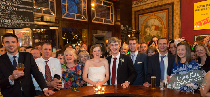 Wedding guests around horseshoe bar at The Peasant Clerkenwell