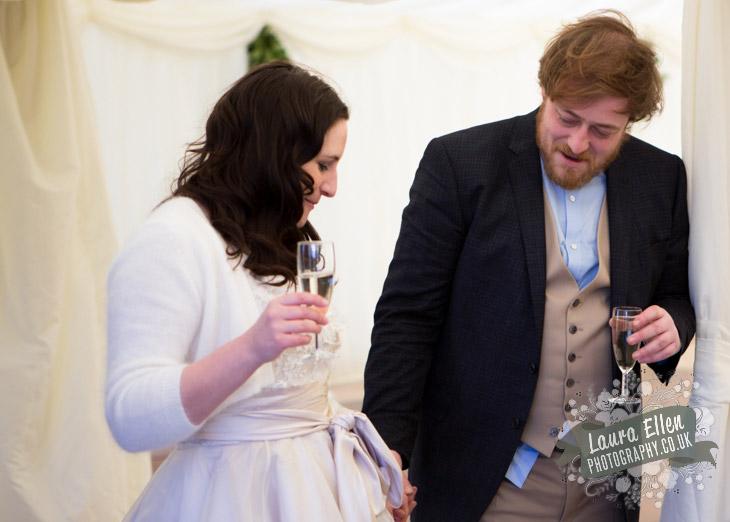Groom admires Bride's wedding dress