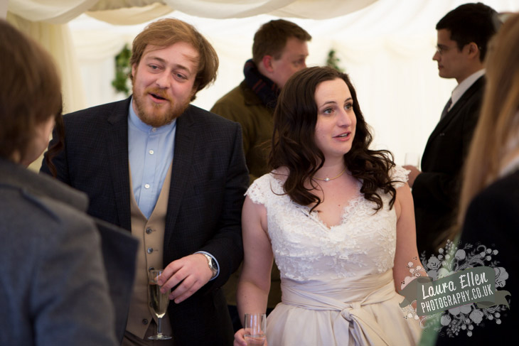 Bride and Groom chatting with guests at Sussex Farm wedding