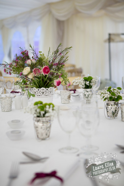 White pink and green wedding reception table flowers and decoration