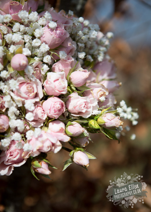 Bride bouquet of pale pink spray rose and white gypsophila