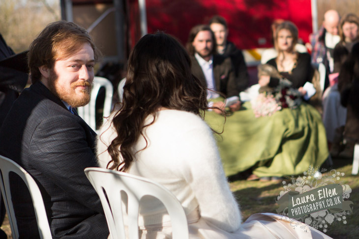 Groom peeks over his shoulder next to Bride
