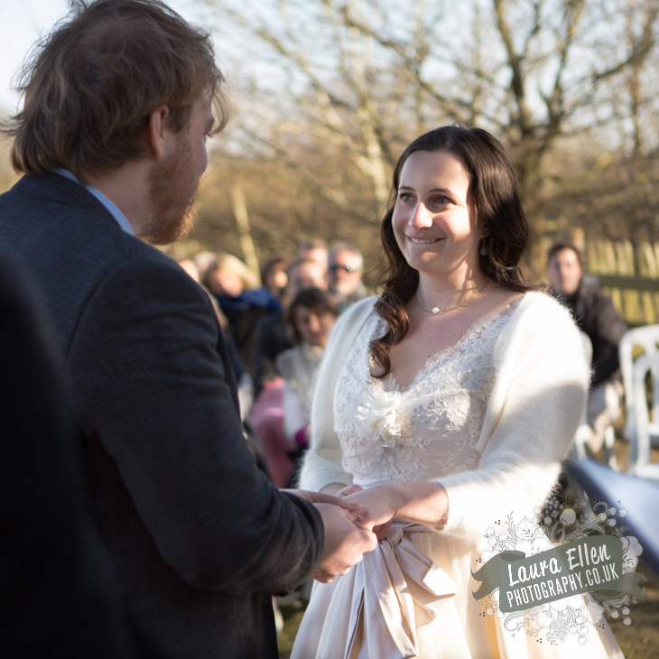 Exchanging rings at East Sussex farm wedding