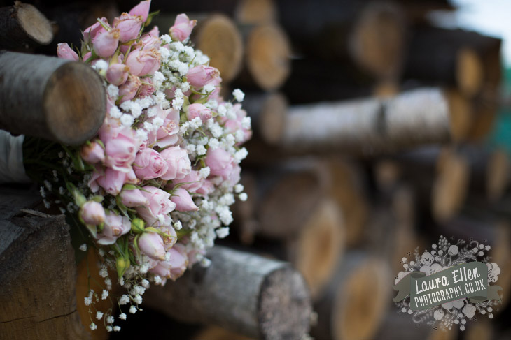 Pale pink rose wedding bouquet in wood store