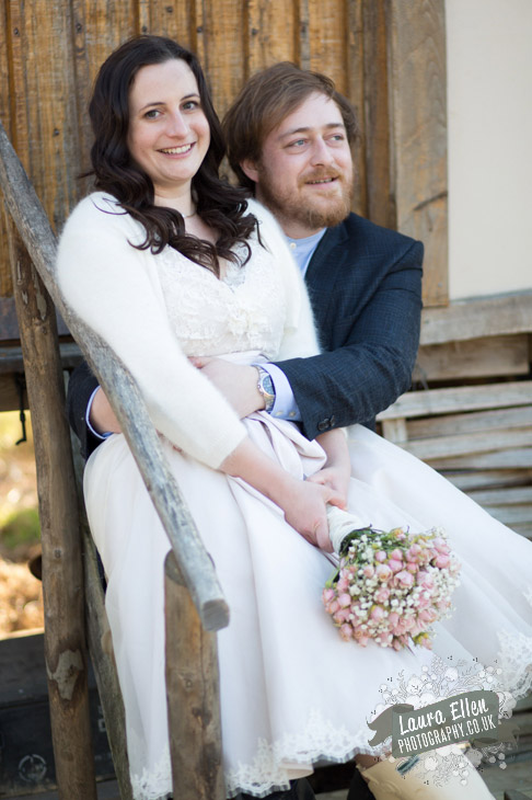 Bride and Groom sitting on steps of Meadow Keepers Cottage