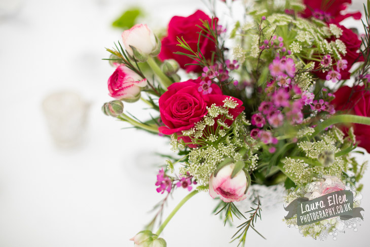 Pink, green and white wedding table flowers