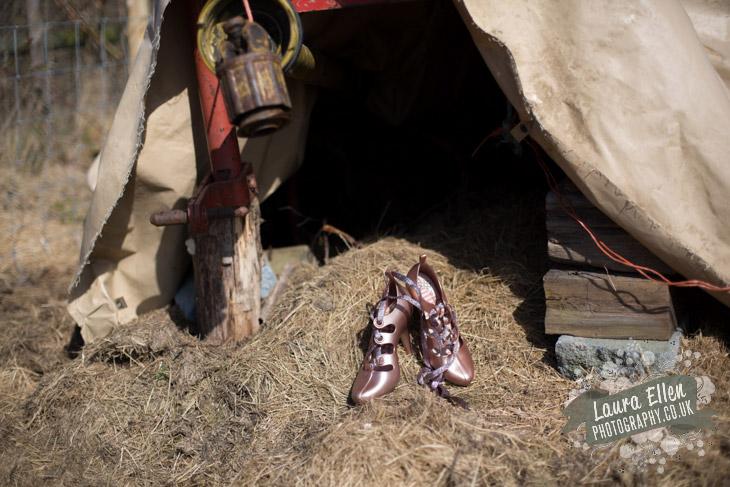 Pink Vivienne Westwood wedding shoes on hay