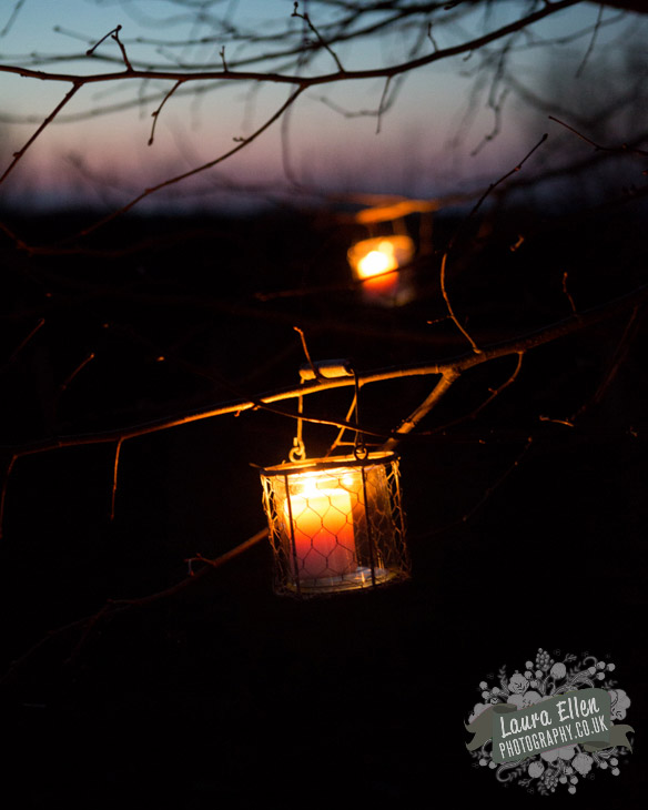 Outdoor night candles in trees