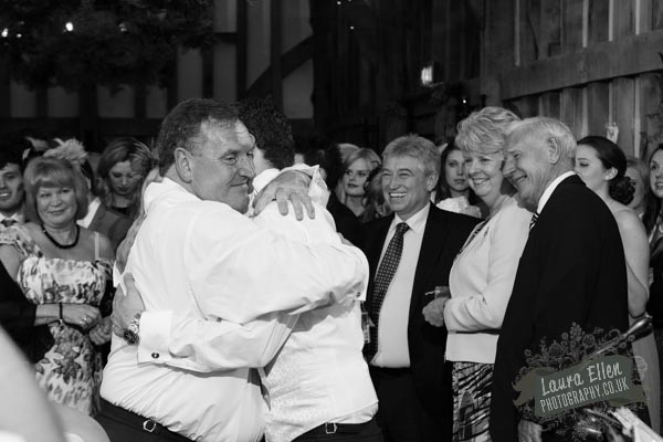 father and son-in-law hugs