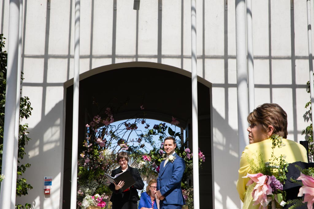 groom with wedding guests at Chiswick House and Gardens