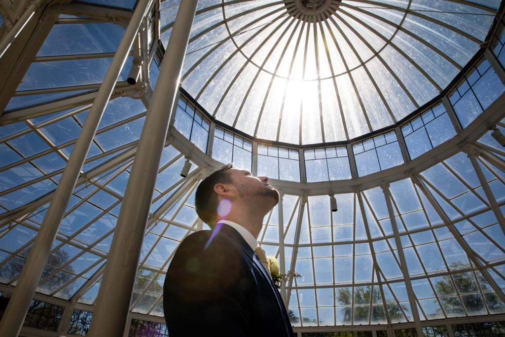 groom in conservatory at Chiswick House Gardens