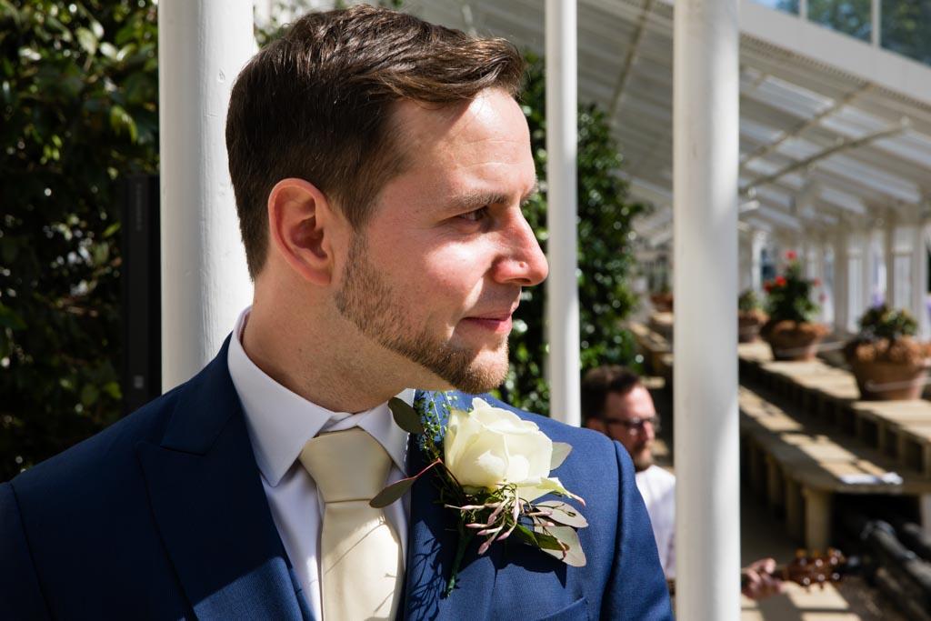 emotional groom awaits his bride