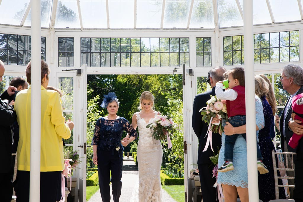 bride walks the aisle at Chiswick House & Gardens Conservatory