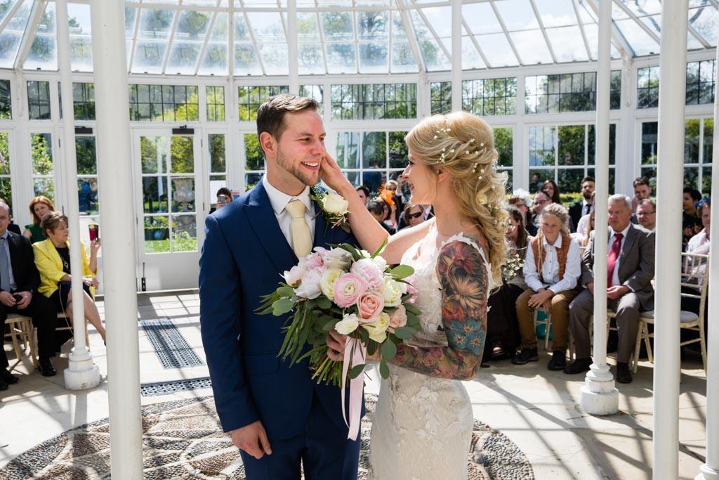 bride wipes tears from groom
