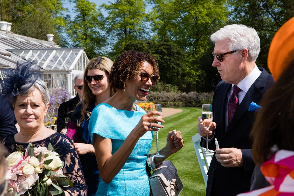 guests enjoying champagne at Chiswick House wedding