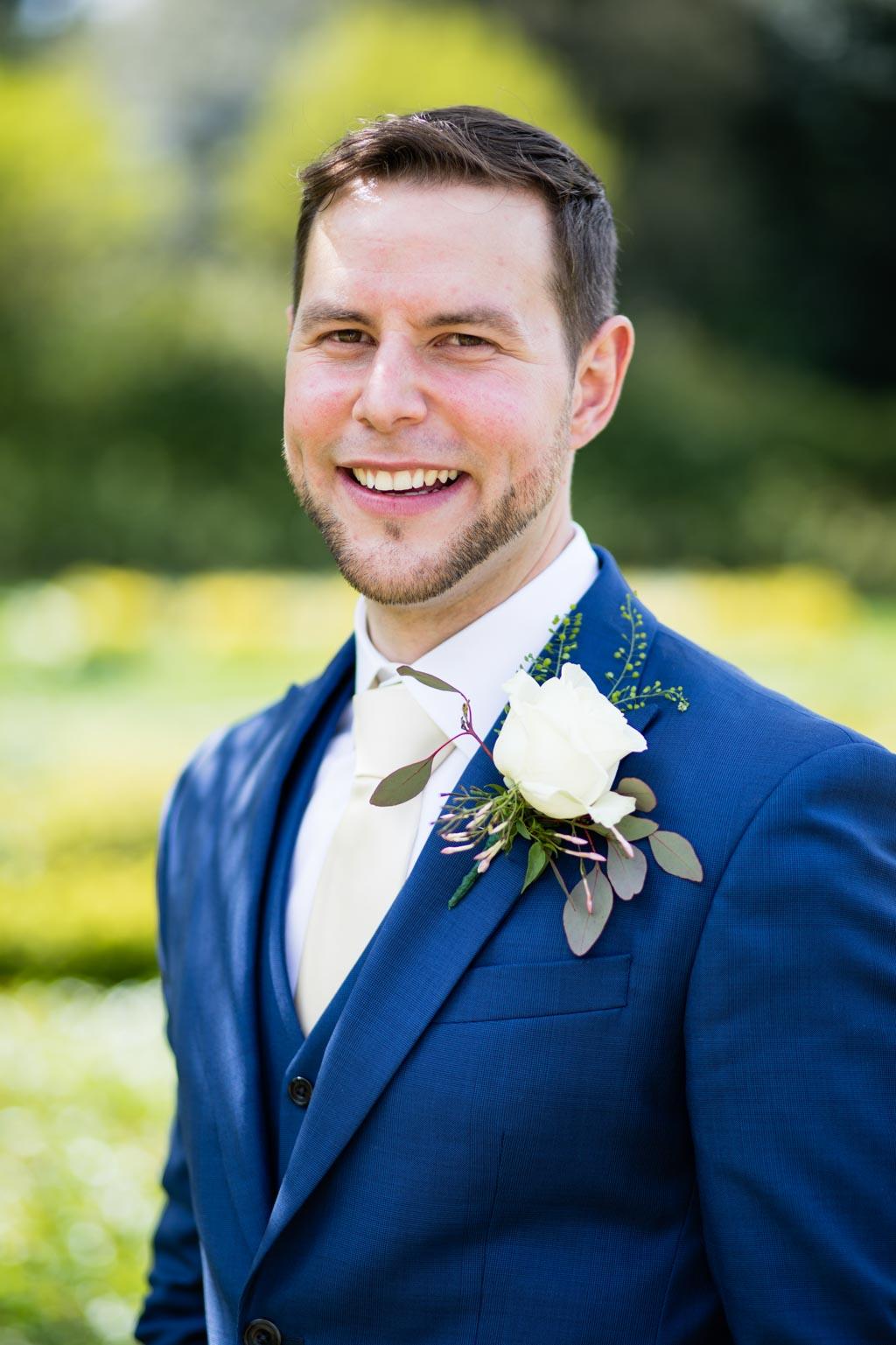 groom portrait wearing navy three-piece suit