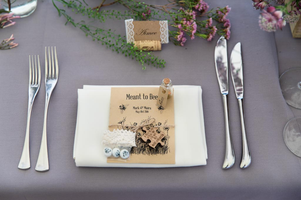 wedding place setting with personalised M&Ms jigsaw and flower seeds favour