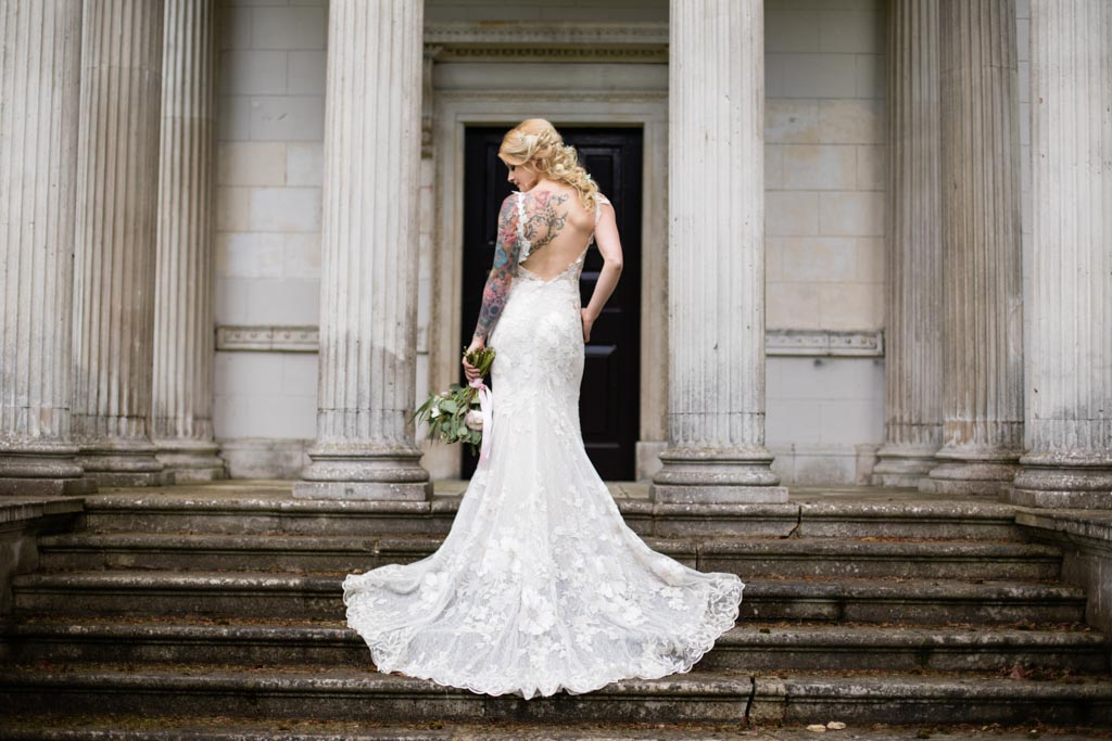 Maira in David Fielden wedding dress standing on the steps of the Temple
