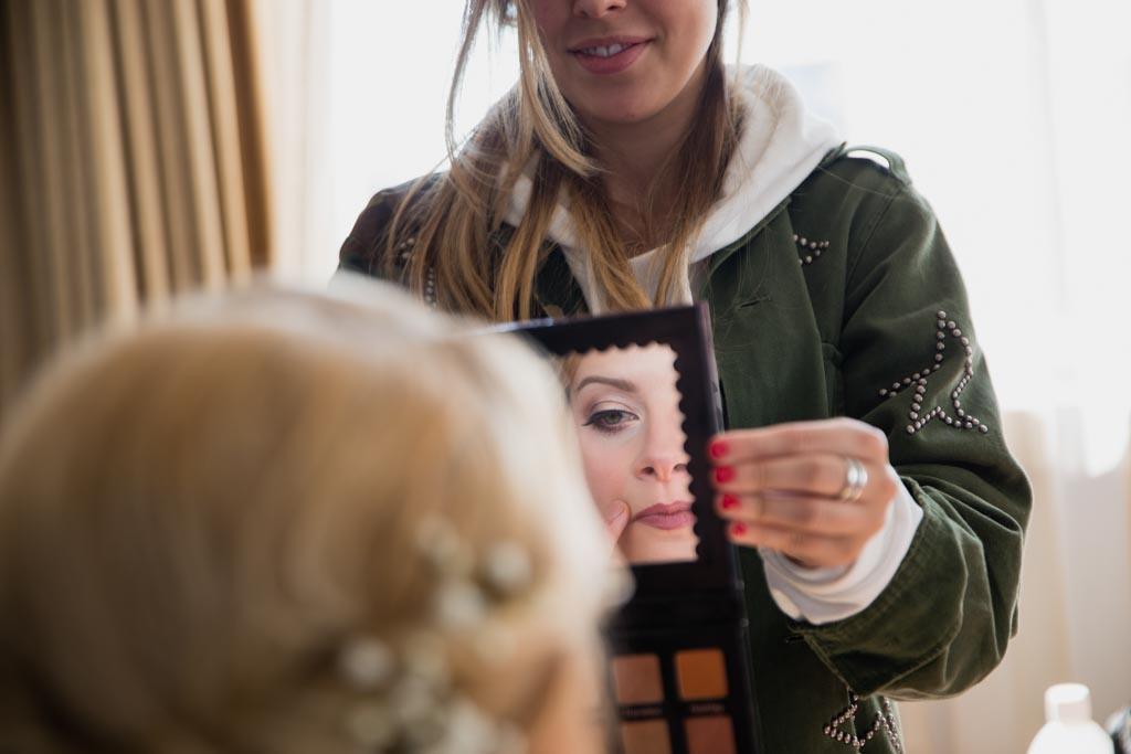 bride checks her make-up
