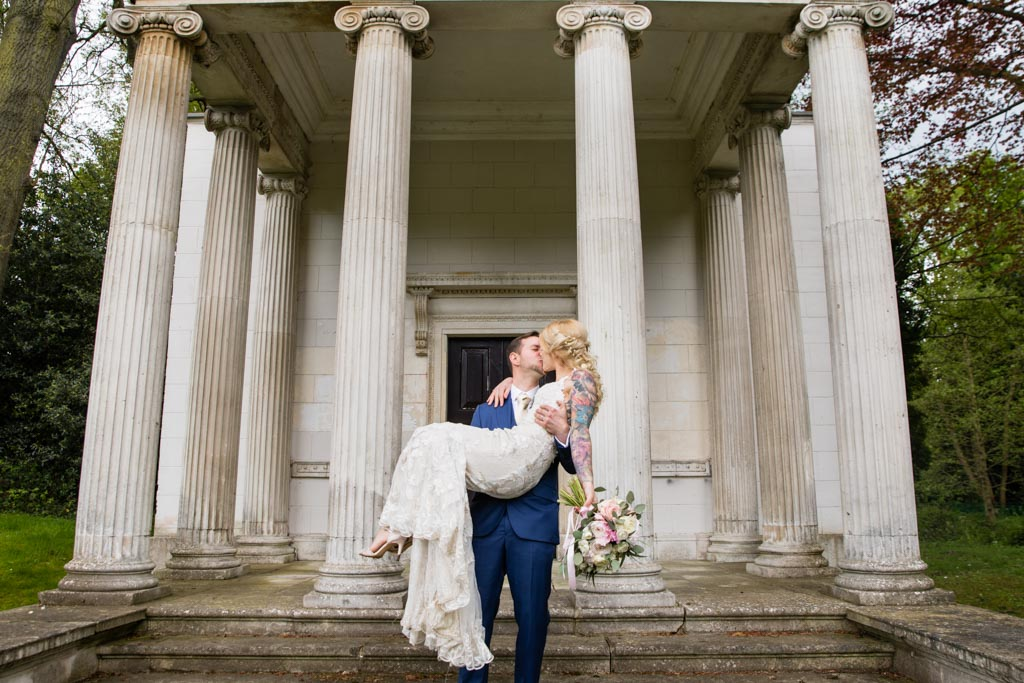 Maira in Mark's arms whilst kissing on the steps of the Temple in London