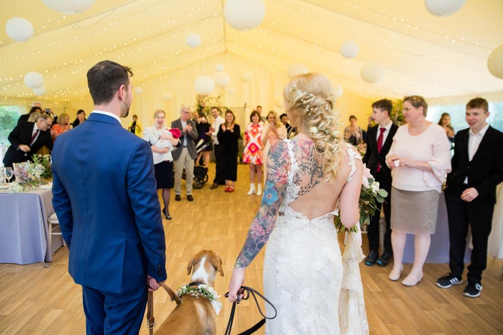 Mark and Maira walk into their wedding reception in The Burlington Pavilion