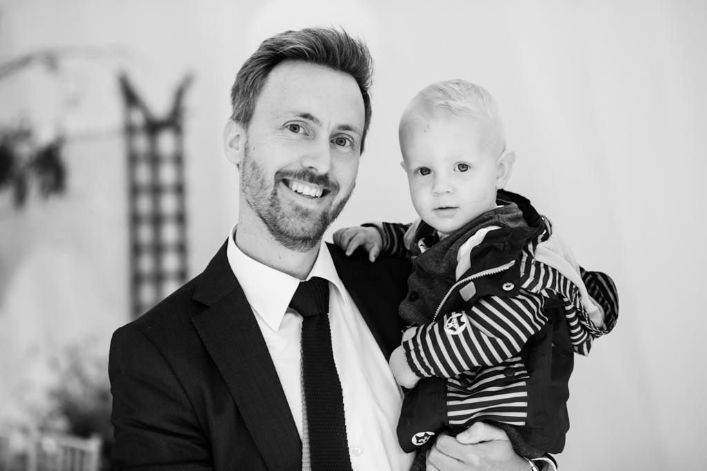 wedding guest hold his baby boy at wedding reception