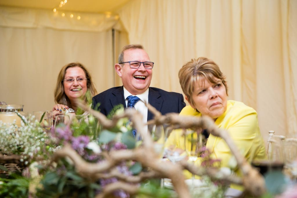 guests on the top table laugh