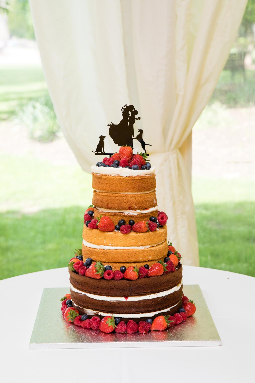 naked sponge wedding cake with summer berries and cream