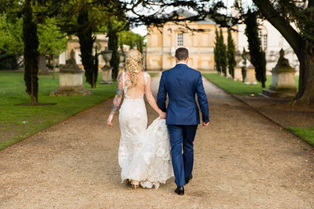 David Fielden bride holds hands with her groom and walk