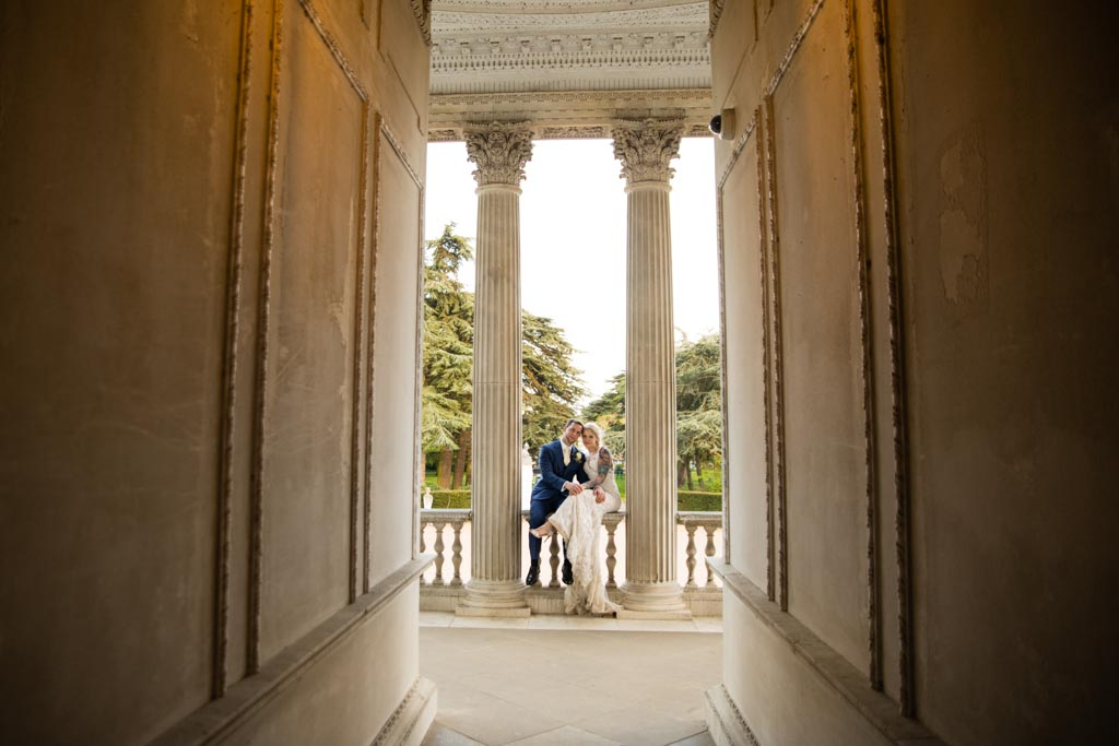 Maira and Mark sit between the columns at Chiswick House