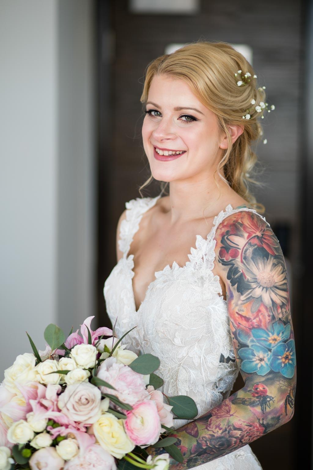 tattooed bride with bouquet portrait