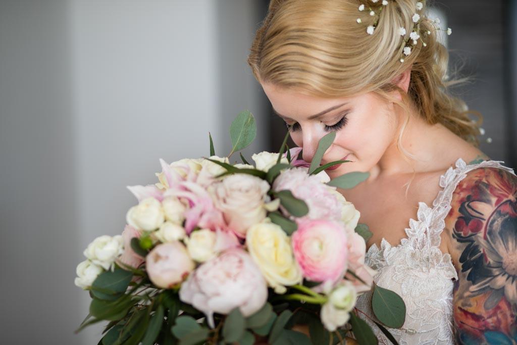 bride smells wedding bouquet