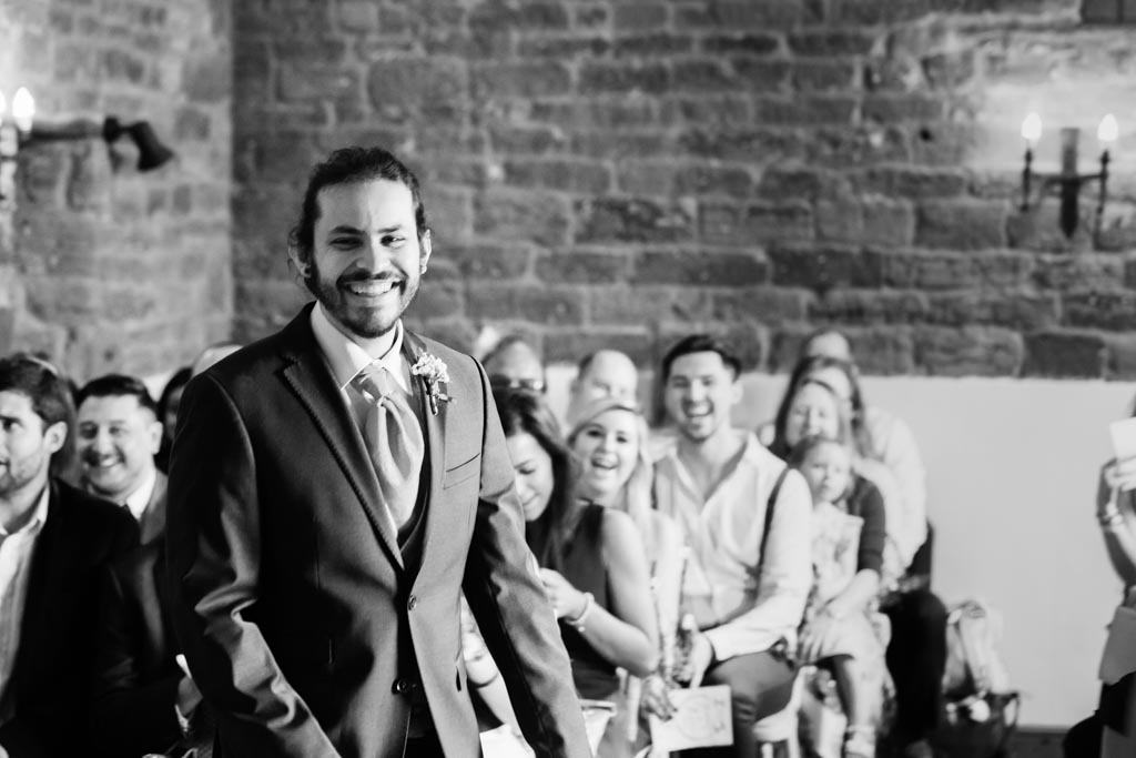 groom walks to ceremony