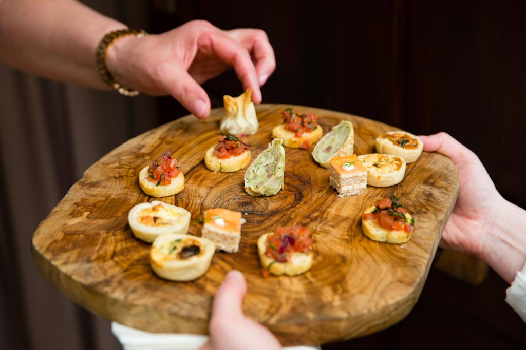 Canapes on wood platter