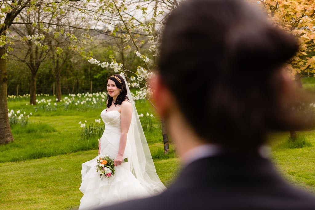 bride looking at groom smiling